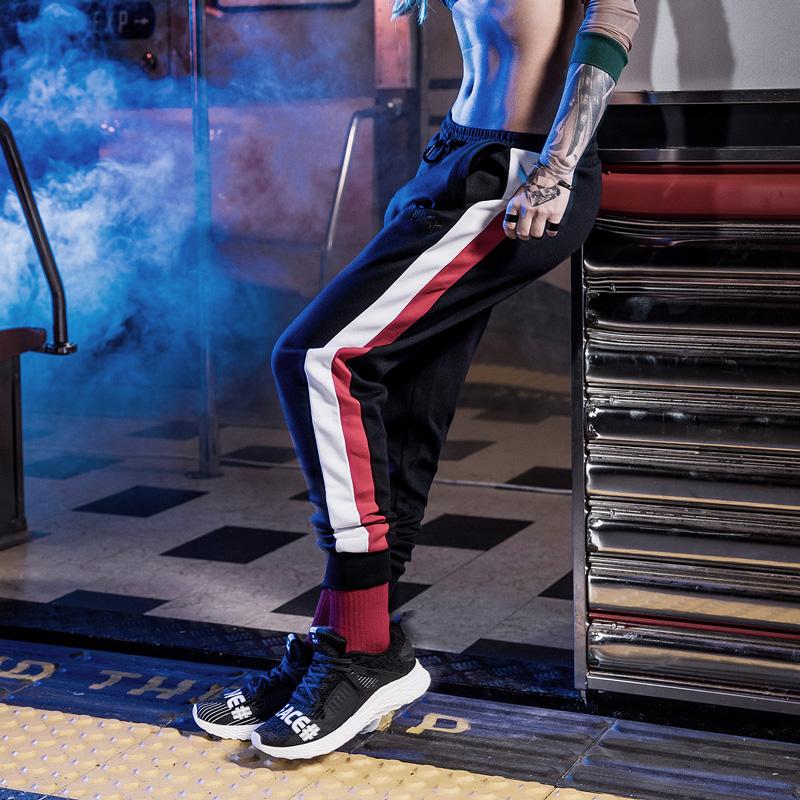特步 女子新款潮流嘻哈拼接针织长裤882328639269